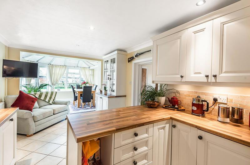 Kitchen through to the conservatory