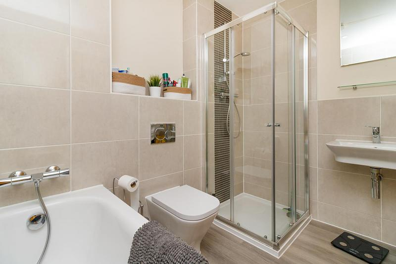 Family bathroom with separate shower cubicle